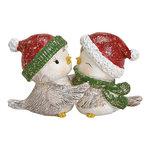 Wintervogelpaar met witte kerstmuts
