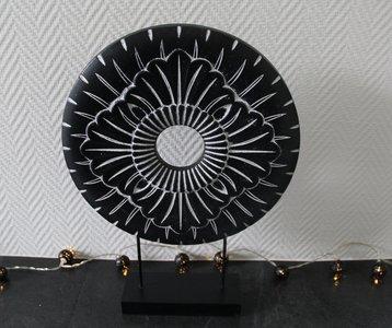 ornament zwart wit rond op voet